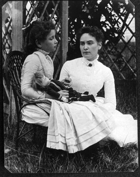 Helen Keller with Anne Sullivan.